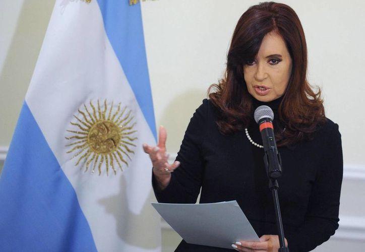 La presidenta Cristina Fernández no podrá acudir al juego amistoso en el estadio de un equipo de segunda que tendrá su nombre. (EFE)