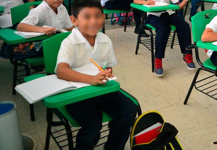 """Según la Secretaría de Educación de Yucatán, en el ciclo escolar 2017-2018, las escuelas podrán, si así lo deciden, """"cambiar"""" clases por curso de verano. La imagen es únicamente ilustrativa. (Archivo)"""