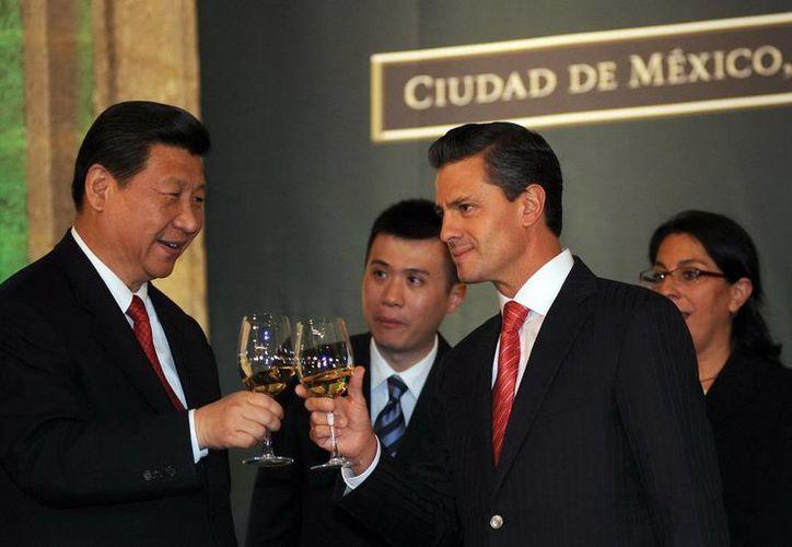 Los presidentes de México y China durante una cena en Palacio Nacional. (Notimex)