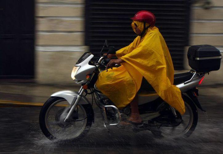 El calor de este domingo será similar al de los últimos días aunque ahora se espera que llueva incluso fuerte. (SIPSE)
