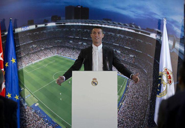 Cristiano Ronaldo extendió su contrato con el Real Madrid hasta finales de la Temporada de 2021.(Paul White/AP)