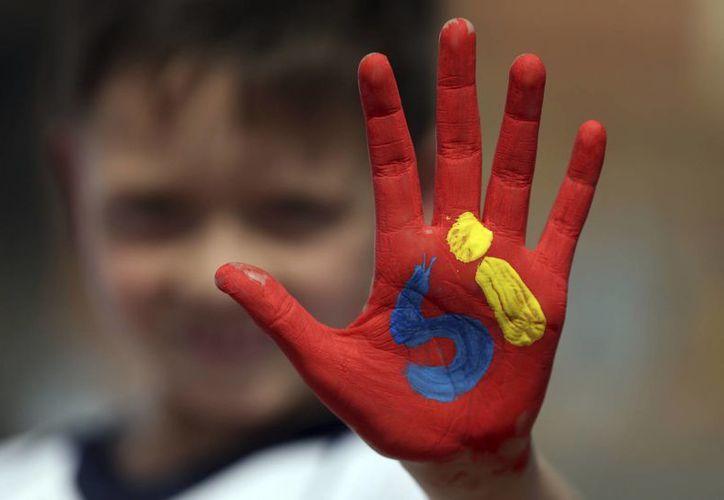 Los medios de comunicación en Colombia no han escatimado en promover la participación en el plebiscito que se realizará este domingo. (AP/Ariana Cubillos)
