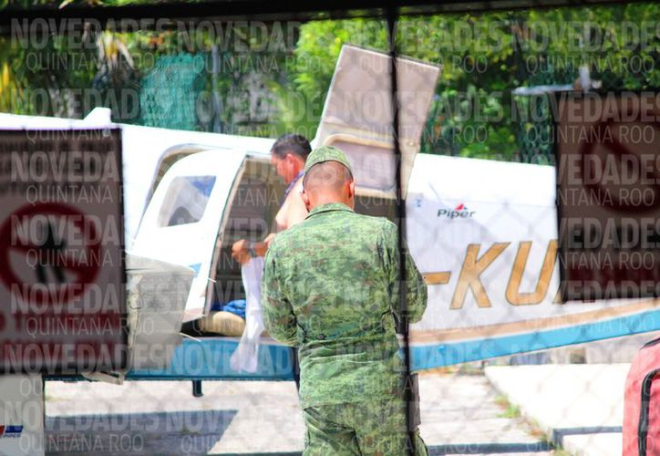 Elementos militares también vigilan las operaciones, accesos y aeronaves. (Daniel Pacheco/SIPSE)