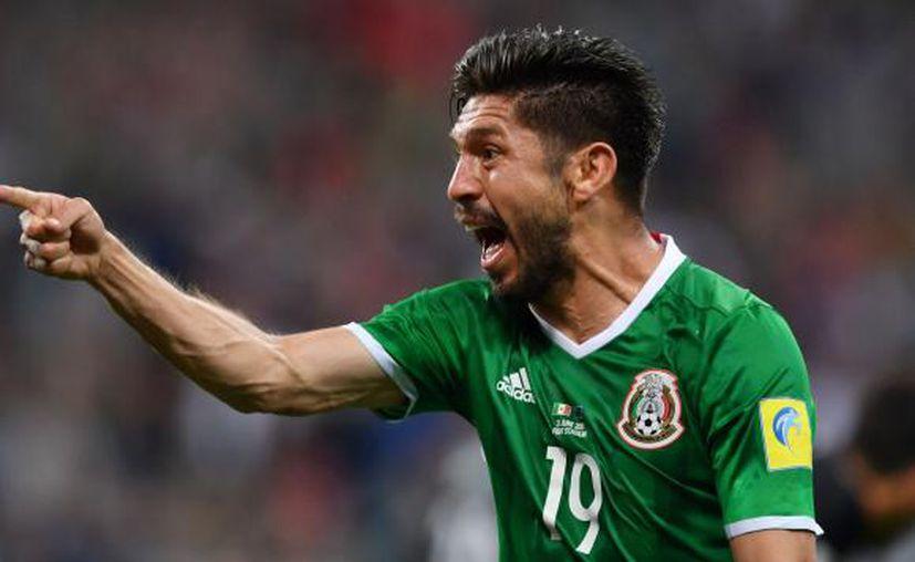 Oribe Peralta fue el encargado de anotar el segundo tanto de los aztecas en el cotejo entre la selección mexicana. (AFP).