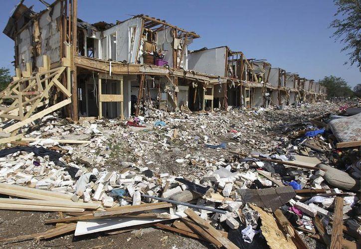 Un complejo de apartamentos destruído por la magnitud de la explosión. (Agencias)