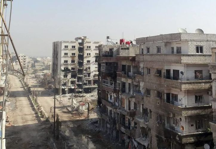 Daños inflingidos en los edificios del área de Daraya, en el Damasco rural. (EFE/Foto de archivo)