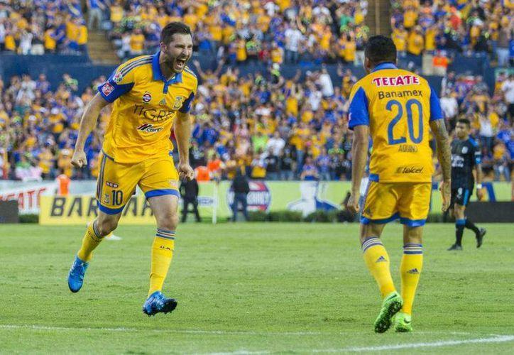 André-Pierre Gignac y Javier Aquino marcaron este sábado los dos goles que dieron la victoria a Tigres este sábado en la segunda jornada de la Liga MX. (Archivo Mexsport)