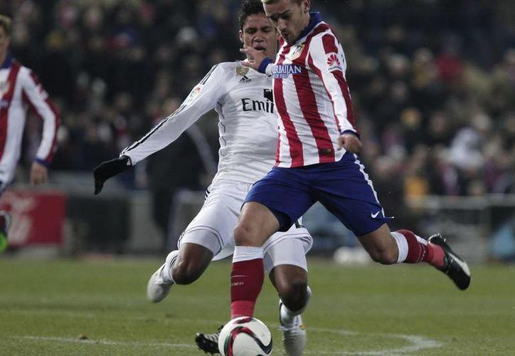 El Atlético de Madrid, que viene de superar 2-0 a Real Madrid en la Copa del Rey jugará este fin de semana como visitante ante Barcelona en partido de Liga de España. (Foto de archivo de Notimex)