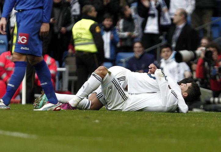 Consideran que Cristiano Ronaldo juega sublime, pero no le llega a Maradona. (Notimex)
