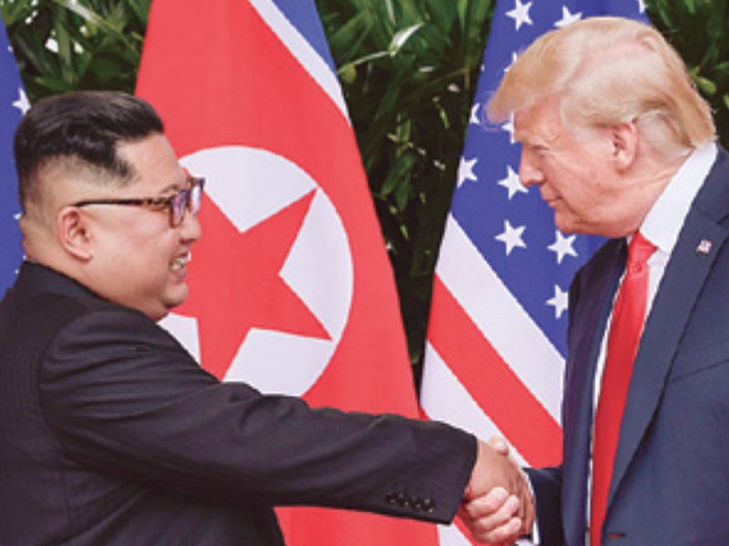 North Korea leader Kim Jong Un, left, and U.S. President Donald Trump shake hands at the conclusion of their meetings at the Capella resort on Sentosa Island in Singapore.