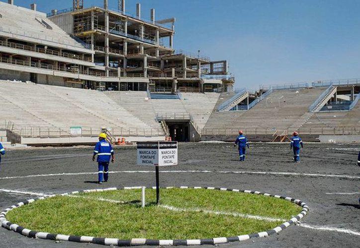 La constructora Andrade Gutierrez aceptó pagar 260 millones de dólares en compensación por contratos fraudulentos con el gobierno, entre ellos la construcción y remodelación de estadios para el mundial Brasil 2014. (Notimex)