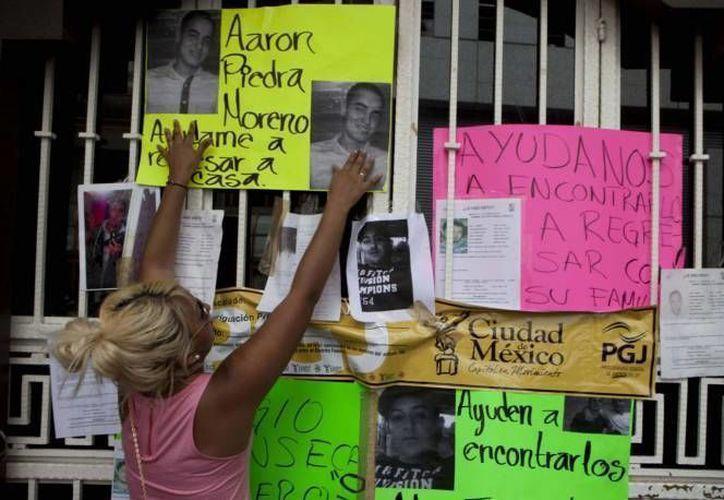 Familiares de los desaparecidos han reclamado varias veces que las autoridades les dan 'largas'. (Archivo Notimex)