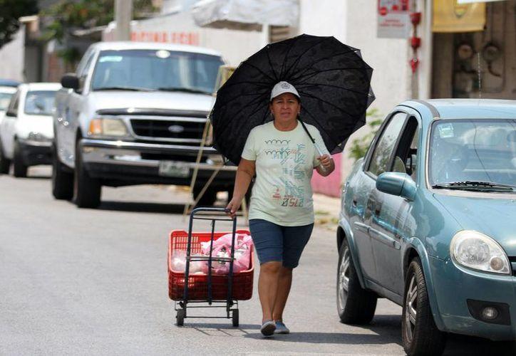 Este sábado la temperatura máxima fue de 34.2 grados en Yucatán. Hoy podría llegar a 36. (Amílcar Rodríguez/Milenio Novedades)