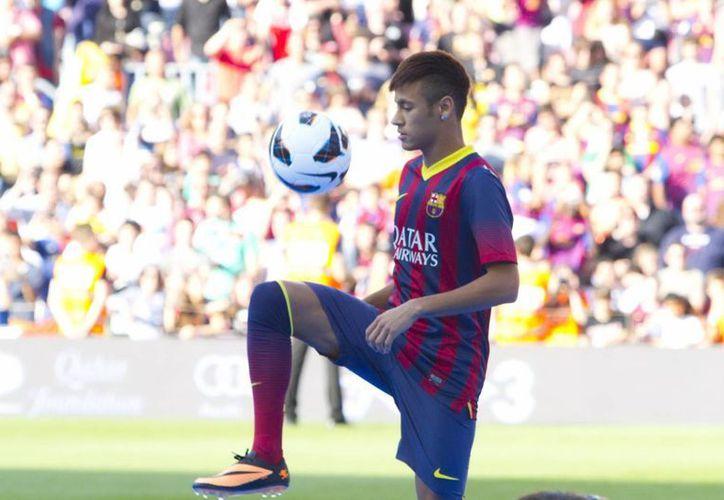 Esperan que con la pérdida de las amígdalas, que le causaban mucho problema, Neymar gane peso y apetito. (Archivo Notimex)