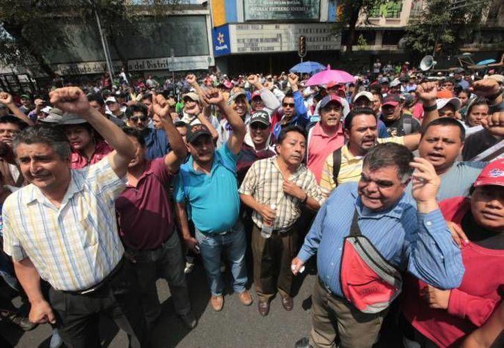 Manifestación de padres de familia en Oaxaca en repudio a los días de clase perdidos. (Notimex/Foto de archivo)