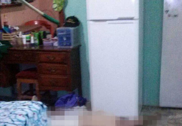 El cuerpo del hombre fue encontrado tendido en el piso de su casa en Dzununcán. (SIPSE)