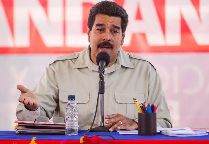 Maduro dijo que la crisis en su país es resultado de una guerra iniciada por la oposición. (Agencias)
