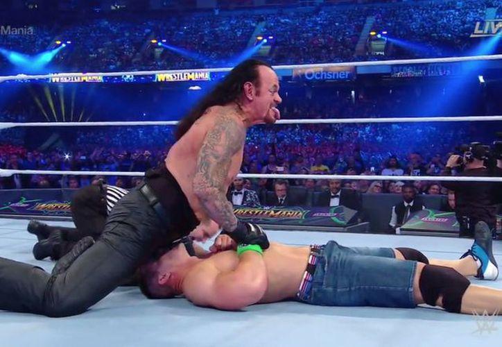 The Undertaker se llevó su victoria 24. (Twitter)