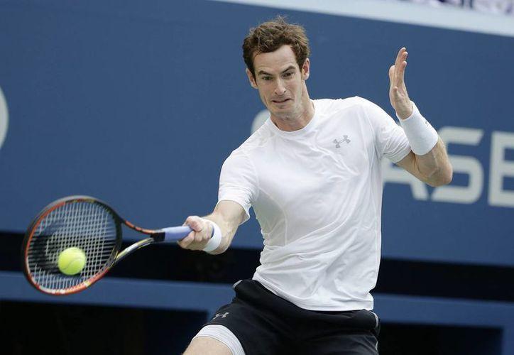 Andy Murray se recuperó luego de ir dos sets abajo y eliminó a en la segunda ronda del Abierto de Estados Unidos. (EFE)
