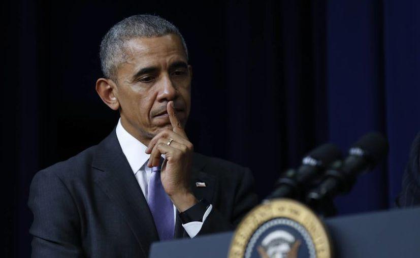 Obama defendió la necesidad de que Trump reciba la valoración diaria de la comunidad de inteligencia. (AP/Carolyn Kaster)