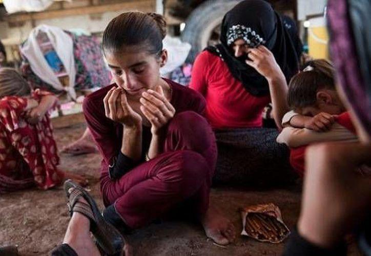 Las mujeres y los menores son vendidas por el Estado Islámico y su precio se establece según su edad. (joeforamerica.com)