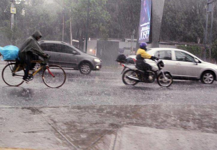 La Península de Yucatán tendrá ambiente medio nublado a nublado, probabilidad de lluvias muy fuertes en Campeche y fuertes en Quintana Roo y Yucatán. (Notimex/archivo)