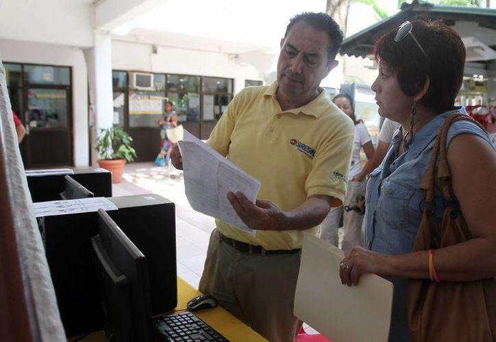Personal de la paramunicipal apoya y asesora a quienes desean regularizarse. (Archivo/SIPSE)