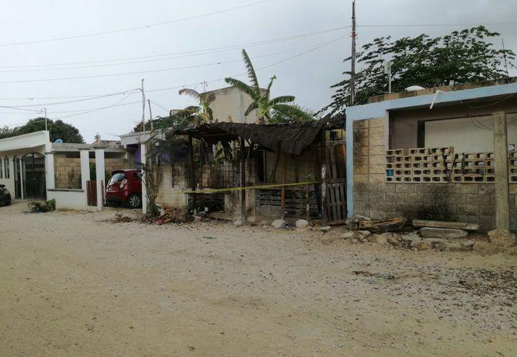 Domicilio donde ejecutaron a dos personas en la Región 227. (Eric Galindo/SIPSE)