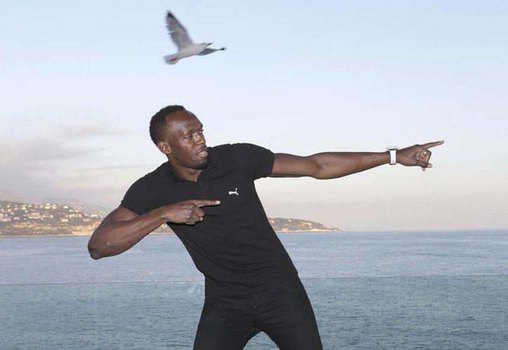 En días pasados, Usain Bolt anunció su retiro del atletismo profesional, debido a que quiere probar suerte en el futbol.(Claude Paris/AP)