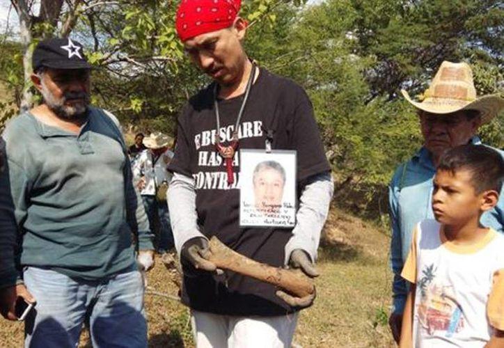 Familiares dijeron que continuarán la búsqueda de restos en las iinmediaciones de Iguala. (Rogelio Agustín/Milenio)