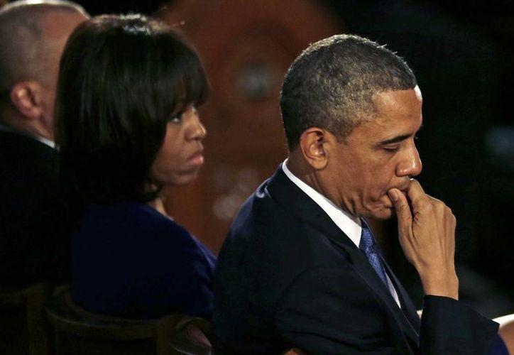 Barack Obama y la primera dama Michelle Obama durante el evento. (Agencia)