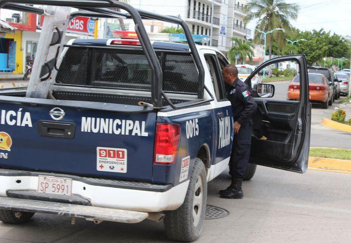 Después de los policías municipales, les sigue los agentes de la Fiscalía General del Estado. (Joel Zamora/SIPSE)