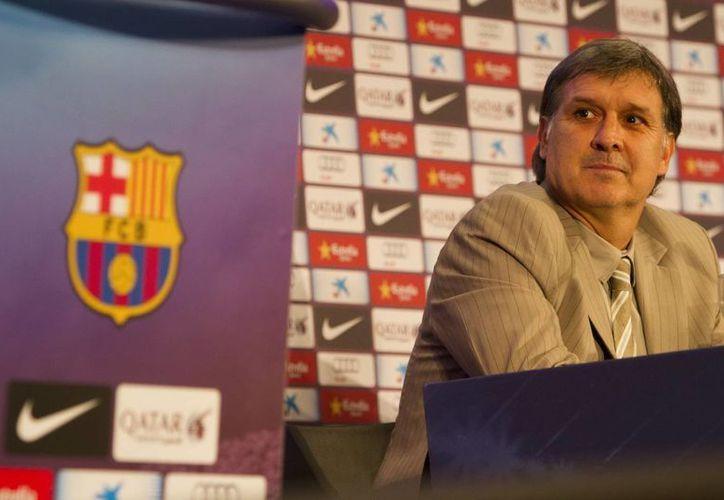 El entrenador argentino no contó ni a su esposa la propuesta que le hizo el presidente del Blaugrana, Sandro Rosell, de dirigir el equipo. (Archivo Notimex)