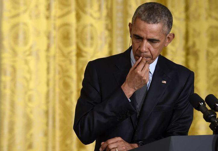 Las medidas dictadas por el presidente Obama en febrero pasado habrían beneficiado a millones de indocumentados, la mayoría mexicanos. (AP)