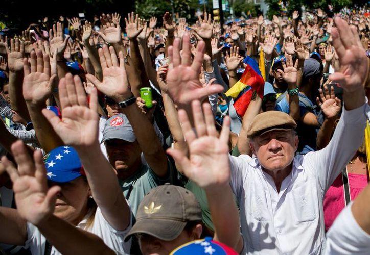 Venezolanos se manifestaron en Caracas y en otras ciudades del mundo contra los hechos violentos en el país sudamericano. La imagen es de la capital venezolana. (Agencias)