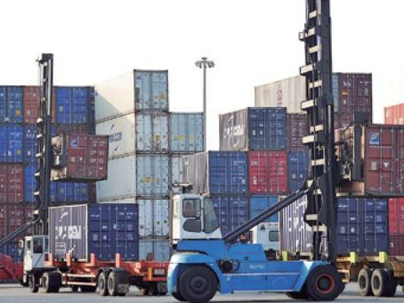 Workers move containers at a port in Qingdao in eastern China's Shandong province. (AP)