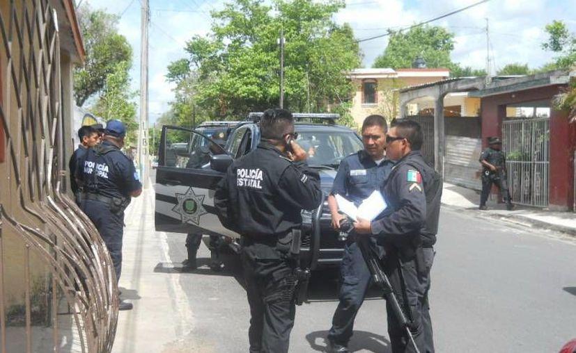 """Agentes de la Policía Estatal llegaron al lugar del """"levantón"""". (Luigi Domínguez/SIPSE)"""