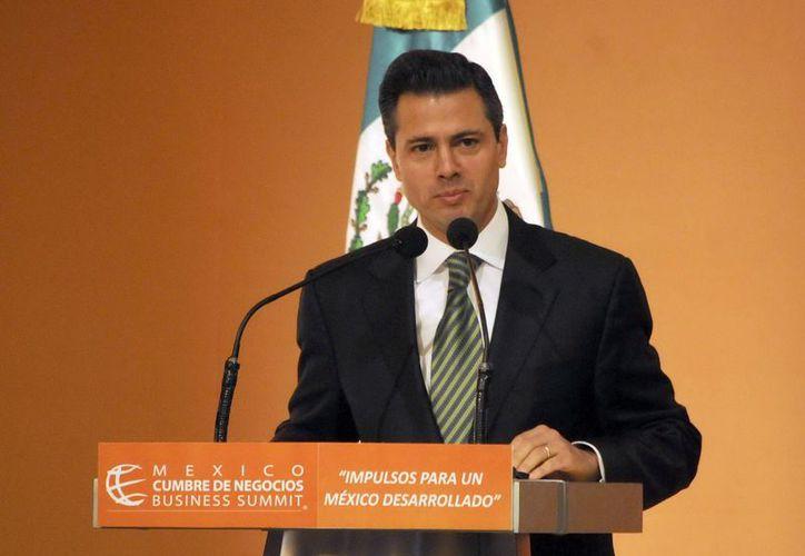 Enrique Peña Nieto hará efectiva dentro de unas horas la alternancia política después de 12 años de gobiernos panistas. (Notimex)