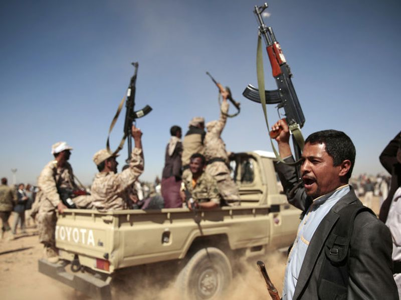 A tribesman loyal to the Houthi rebels, right, chants slogans during a gathering aimed at mobilizing more fighters.