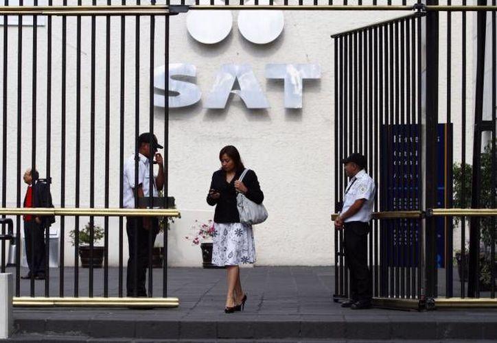 El SAT hará devoluciones a quienes cumplan con tiempo y forma en sus obligaciones fiscales y tengan saldo a favor. (Notimex/Contexto)