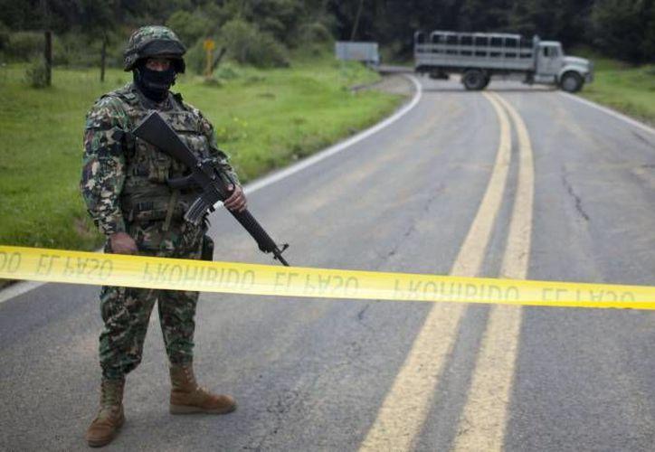 Los hechos por los que se acusa a los militares se registraron en la comunidad San Pedro Limón, del municipio mexiquense de Tlatlaya, el pasado mes de junio. (Archivo/SIPSE)