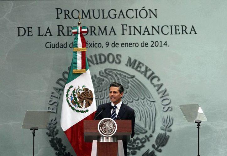 Tras ser aprobada en noviembre por el Congreso, la Reforma Financiera fue promulgada este jueves por el presidente Enrique Peña Nieto. (Notimex)