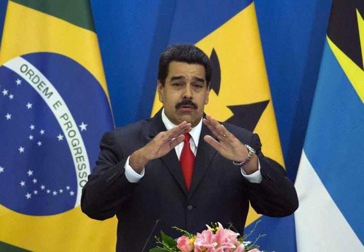 El presidente de Venezuela, Nicolás Maduro, habla en la ceremonia de apertura de la reunión de dos días entre China y países de América Latina y el Caribe, en el Gran Palacio del Pueblo en Beijing, China. (Agencias)