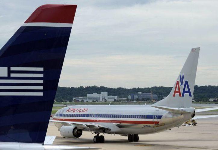 La fusión de American Airlines al lado de uno de US Airways crearía la aerolínea más grande del mundo. (Agencias)
