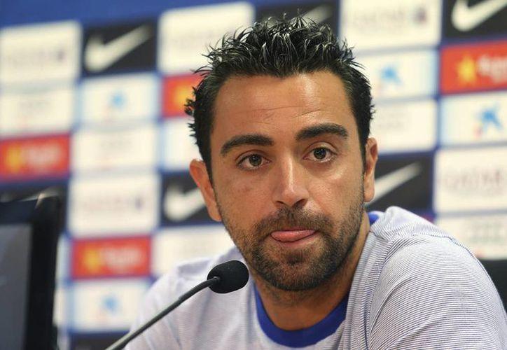 Ofertas del New York City y de un equipo catarí habrían influido en la decisión de Xavi Hernández de salir del Barcelona. (EFE)