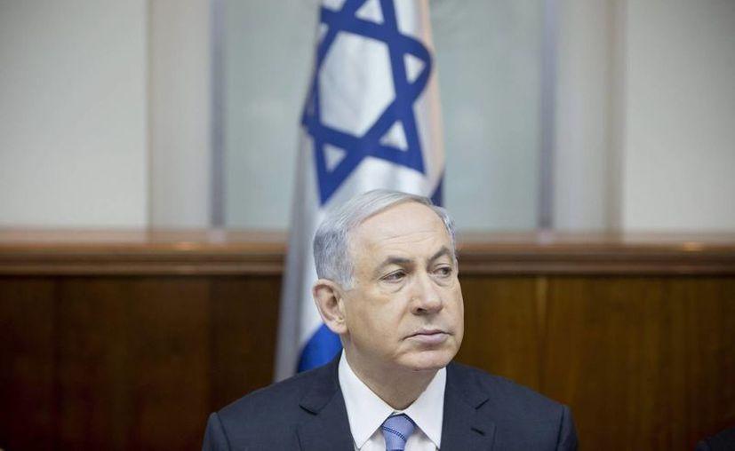 El primer ministro israelí, Benjamín Netanyahu, pidió al presidente de Francia   intensificar la seguridad en los centros e intereses judíos en el país. (Archivo/EFE)