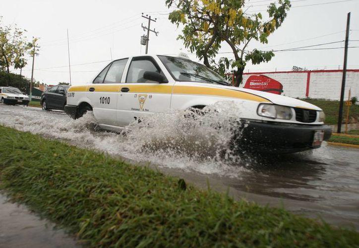 Hasta el mediodía, el registro de lluvia fue de 30 milímetros. (Harold Alcocer/SIPSE)