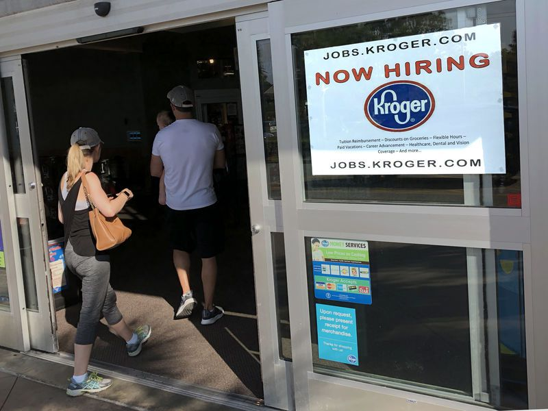 In this photo, a hiring sign hangs in front of a Kroger's grocery store in Hilton Head, S.C. The Labor Department reports on job openings and labor turnover for April.