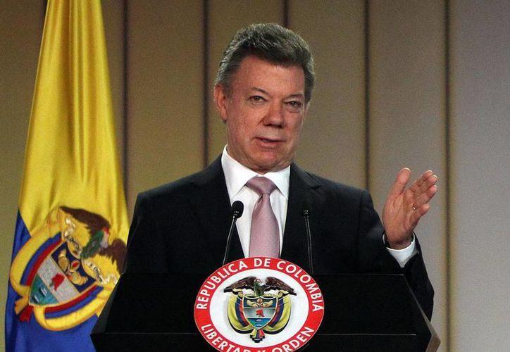 El presidente Juan Manuel Santos insinuó el sábado querer pertenecer a la OTAN. (Archivo/EFE)