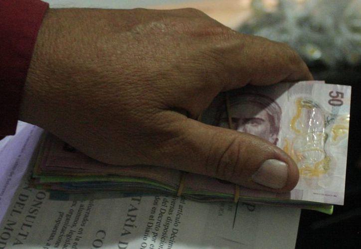 El 60% de los directivos de las empresas en México considera que los actos de corrupción se han convertido en una actividad común. (Harold Alcocer/SIPSE)